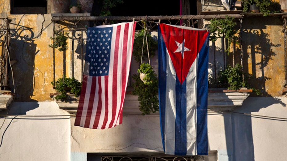 Mixed reaction to shift on Cuba