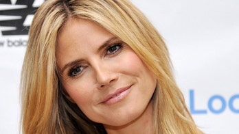 Heidi Klum poses topless while vacationing in Hong Kong with fiance Tom Kaulitz