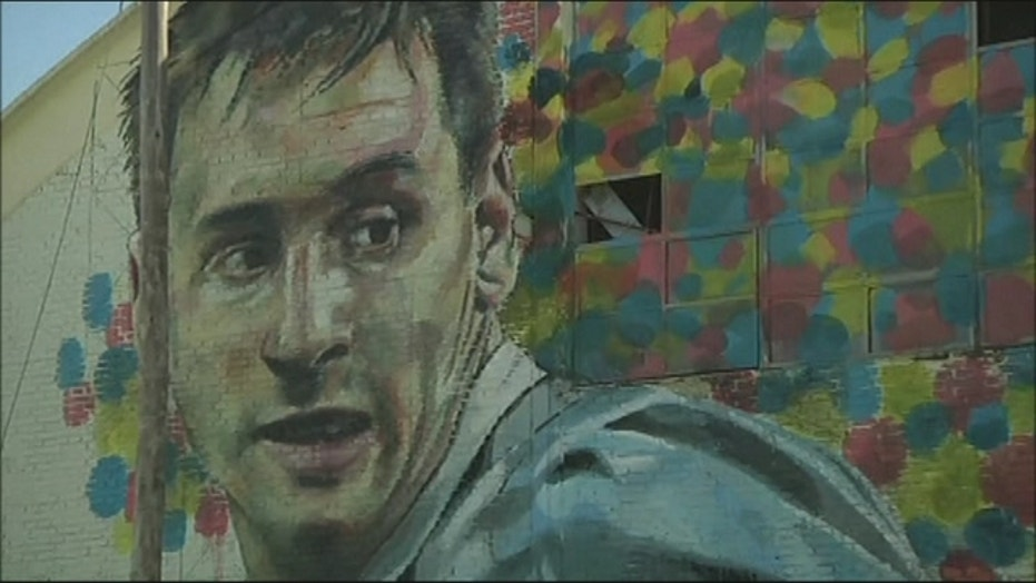 Street artists create mural of Lionel Messi