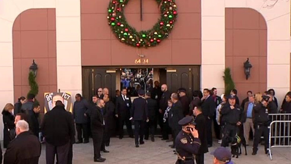 Thousands gather outside the funeral for Rafael Ramos