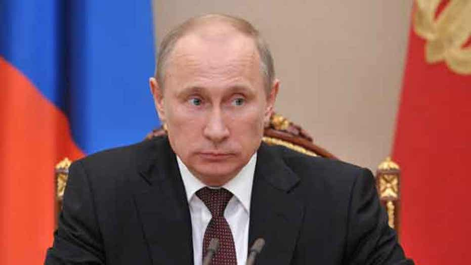 Putin signs law banning adoptions by American families