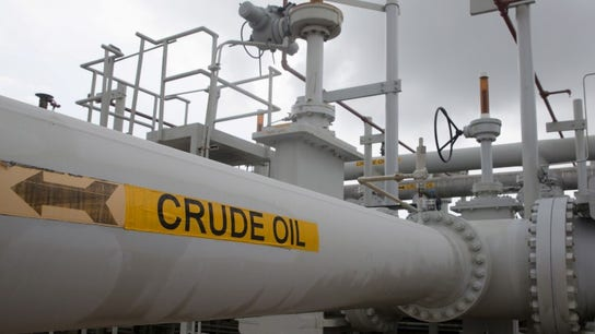 Oil slips to $66 a barrel as U.S. output offsets OPEC curbs