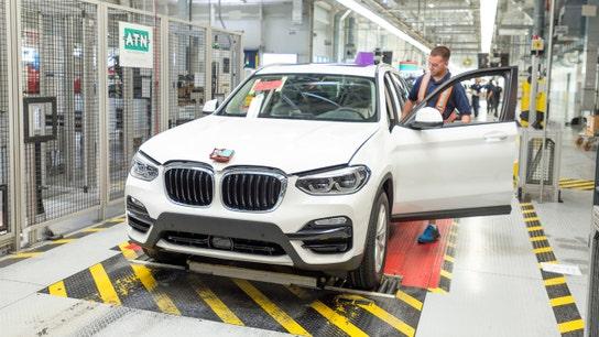 BMW warns that trade spat will drag on sales, profit