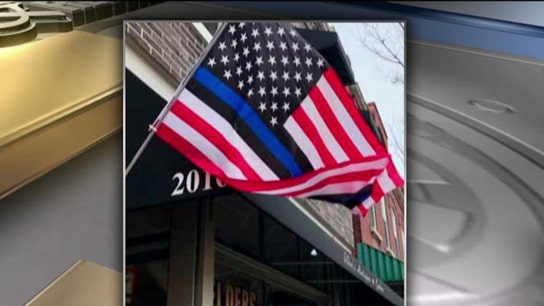 Pro-cop small business owner threatened over American flag