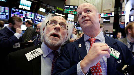 Stocks close lower as Fed minutes trigger volatility