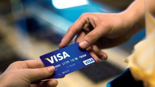 Kroger grocery unit bans Visa credit cards