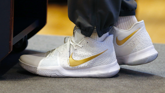 Nike posts loss due to tax law, but beats expectations