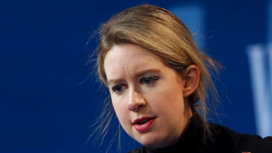 Theranos founder Elizabeth Holmes resigns from firm she founded