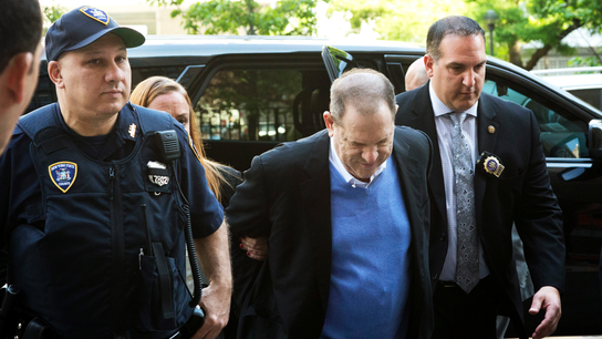 Handcuffed Weinstein faces rape charge in #MeToo reckoning