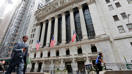 Stocks end slightly lower as traders shrug off trade talk