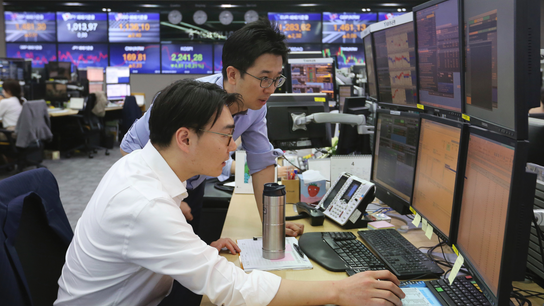 Global stocks subdued as investors eye earnings, data