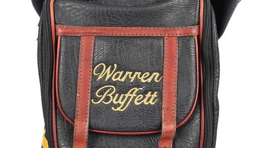 Warren Buffett's personal golf club set nets nearly $40,000 at auction