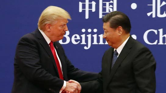 Trump, amid heightened trade tensions, says things are 'going along very well with China'