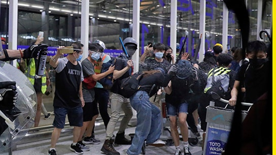 Hong Kong protesters mob airport as clashes turn violent, flights canceled