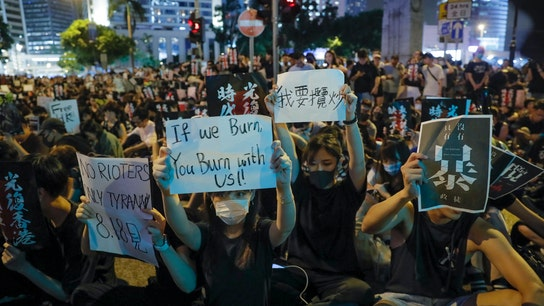 Hong Kong protest organizer challenges Trump to help 'contain China'