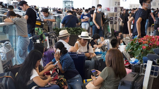 HONG KONG FLIGHTS RESUME AS TENSION REMAIN