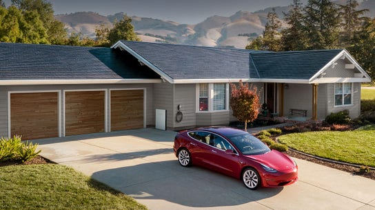 Tesla testing solar roof as Musk promises production ramp