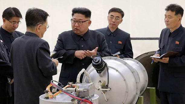 Kim Jong Un at an undisclosed location in North Korea with what appeared to be a warhead.