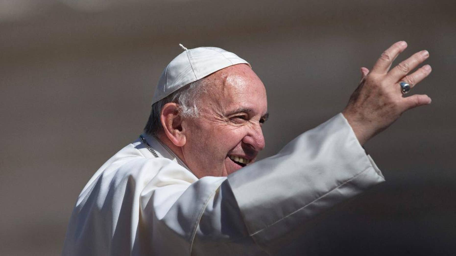 Pope Francis waves to the crowd as he arrives for his weekly general audience in St. Peter's Square at the Vatican, Wednesday, May 18, 2016. (AP Photo/Alessandra Tarantino)