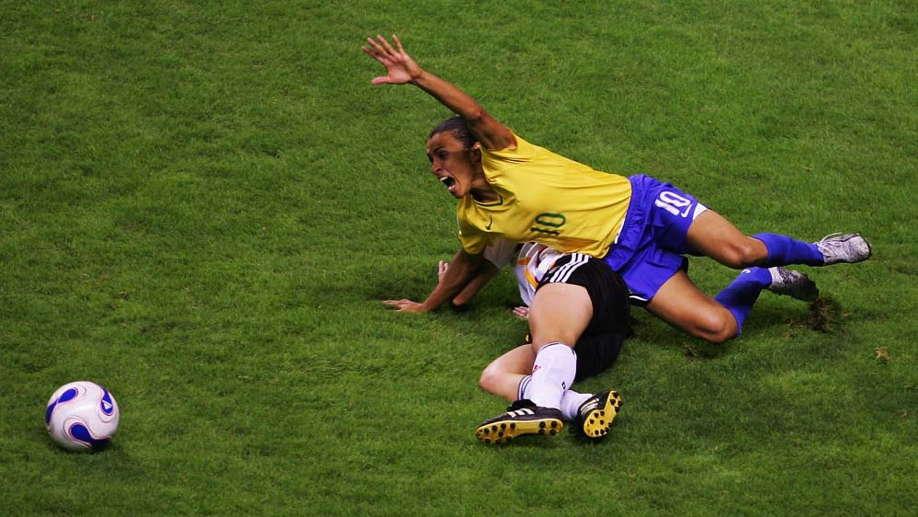 SHANGHAI, CHINA - SEPTEMBER 30: Marta (#10) of Brazil in action during the Women's World Cup 2007 final between Germany and Brazil at Shanghai Hongkou Football Stadium on September 30, 2007 in Shanghai, China. (Photo by Guang Niu/Getty Images)