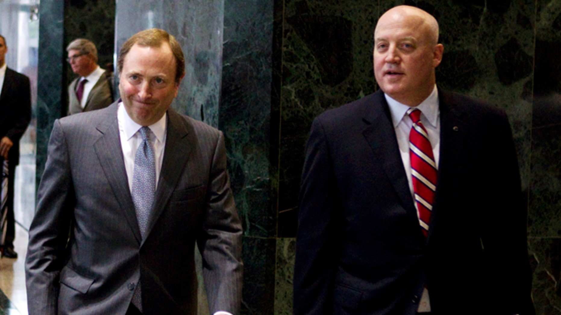 Aug. 14, 2012: This file photo shows NHL commissioner Gary Bettman, left, and Bill Daly, deputy commissioner and chief legal officer, following collective bargaining talks in Toronto.