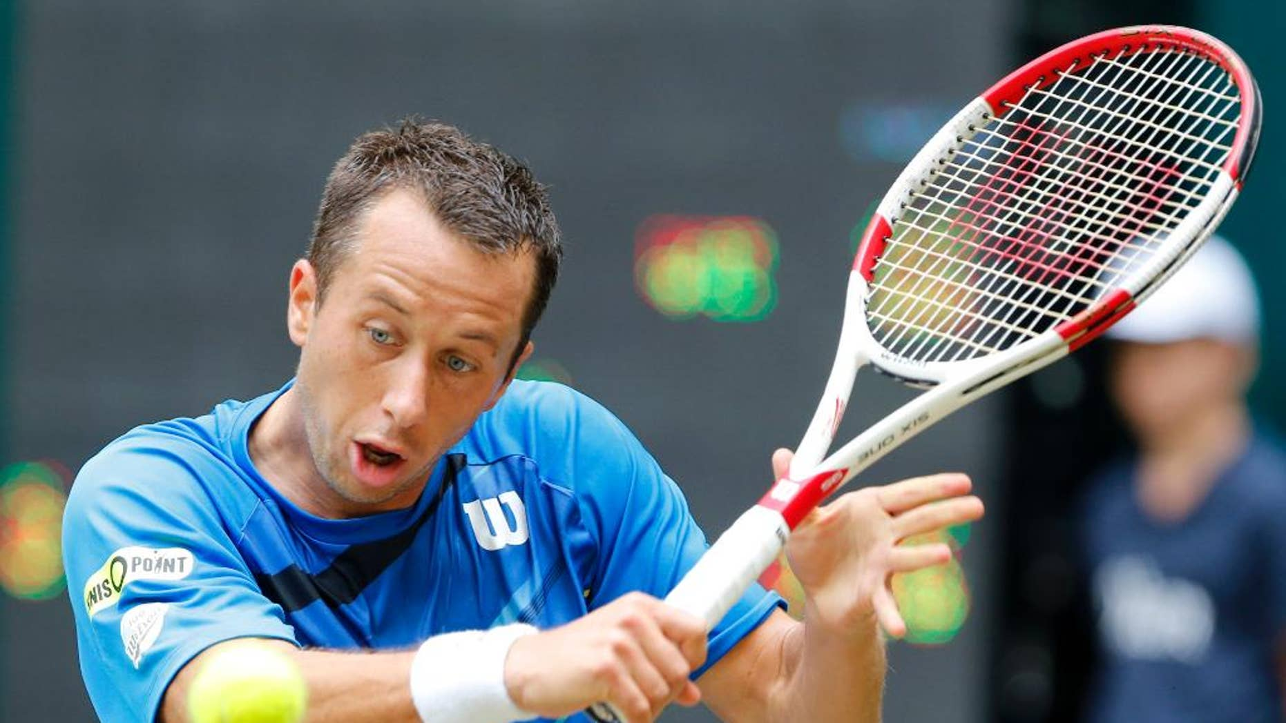 Germany's Philipp Kohlschreiber hits a backhand against Colombia's Alejandro Falla during the semifinal match of the the Gerry Weber Open tennis tournament in Halle, Germany, Saturday, June 14, 2014. Falla won the match with 5-7, 7-6, 6-4. (AP Photo/Michael Probst)