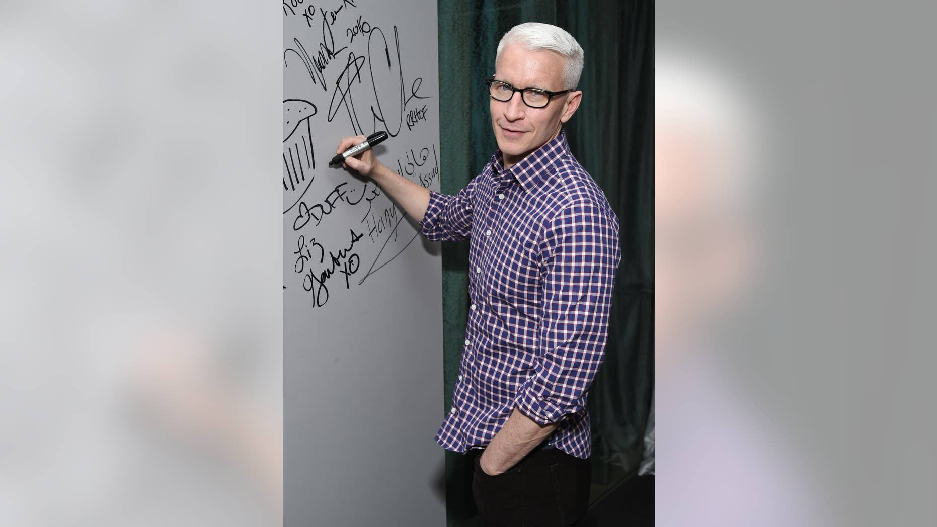 """FILE - In this April 15, 2016 file photo, CNN News anchor Anderson Cooper appears at AOL's BUILD Speaker Series to discuss the HBO documentary, """"Nothing Left Unsaid"""", at AOL Studios in New York. Cooper's name has been circulating as a possible replacement for Michael Strahan on the morning talk show, """"Live! With Kelly and Michael."""" Strahan, who started in 2012, is leaving to work full-time at """"Good Morning America"""" and ABC announced that his last day will be on May 13. (Photo by Evan Agostini/Invision/AP, File)"""