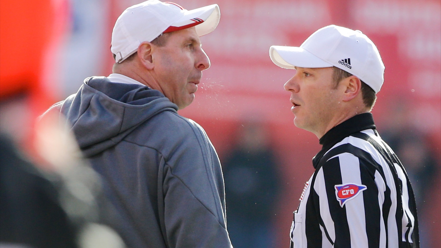 Nebraska head coach Bo Pelini, left, protests a pass interference call with referee Alex Kemp, right, in the third quarter of an NCAA college football game against Iowa in Lincoln, Neb., Friday, Nov. 29, 2013. Iowa won 38-17. (AP Photo/Nati Harnik)