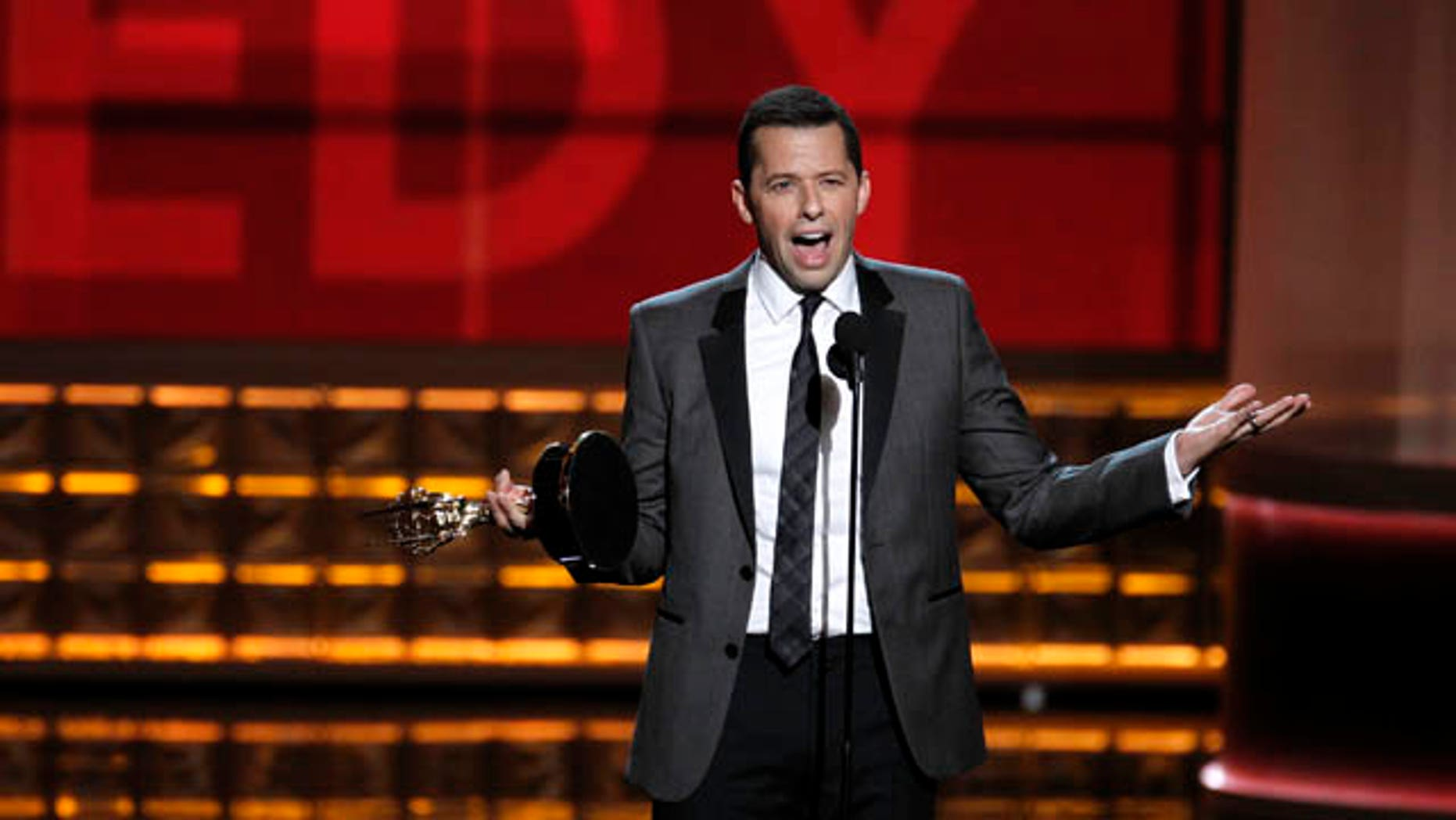 """Jon Cryer accepts the award for outstanding lead actor in a comedy series for his role in """"Two and a Half Men"""" at the 64th Primetime Emmy Awards in Los Angeles, September 23, 2012.    REUTERS/Lucy Nicholson (UNITED STATES  - Tags: ENTERTAINMENT)  (EMMYS-SHOW)"""