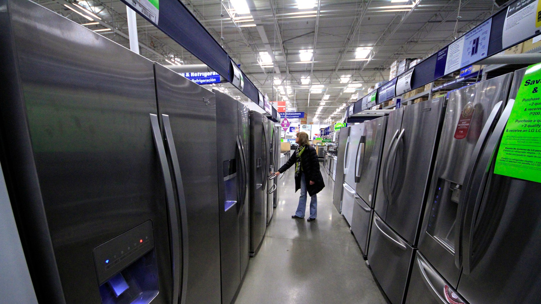 In this Thursday, Jan. 16, 2014, photo,  a woman walks through a display of refrigerators at a Lowe's store in Cranberry Township, Pa.  The Commerce Department releases durable goods for January on Thursday, Feb. 27, 2014. (AP Photo/Gene J. Puskar)