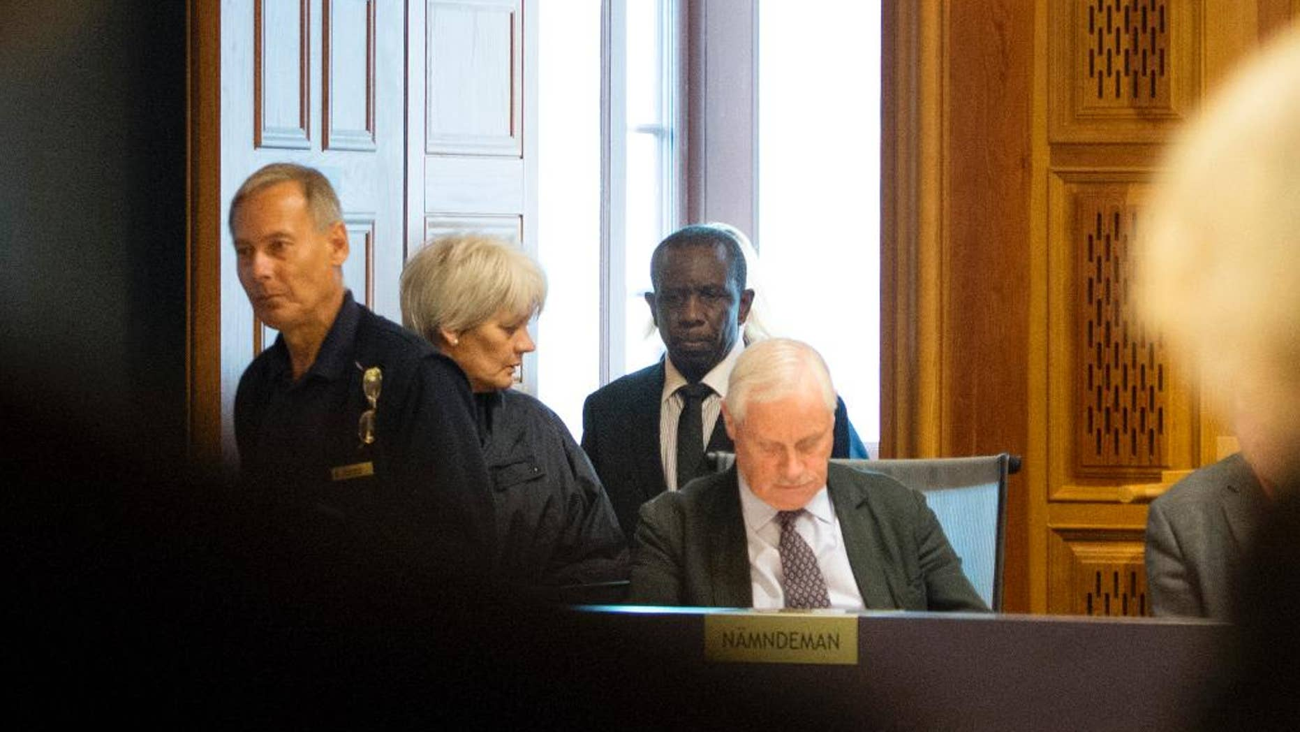 This is  Sept. 16, 2015  file picture shows Claver Berinkindi, second from right a Swedish citizen originally from Rwanda. Claver Berinkindi on Monday May 16, 2016  was found guilty of genocide and gross violation of international law. The Stockholm district court said the 61-year-old was an informal low-level Hutu leader who took part in massacres of civilians in Muyira and Butare in southern Rwanda.. (Jessica Gow/TT via AP) SWEDEN OUT