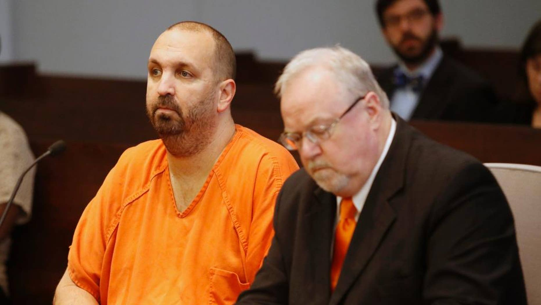 April 6, 2015: Murder defendant Craig Stephen Hicks, 46, left, listens while his co-defense counsel Terry Alford makes notes during a death penalty hearing for Hicks.