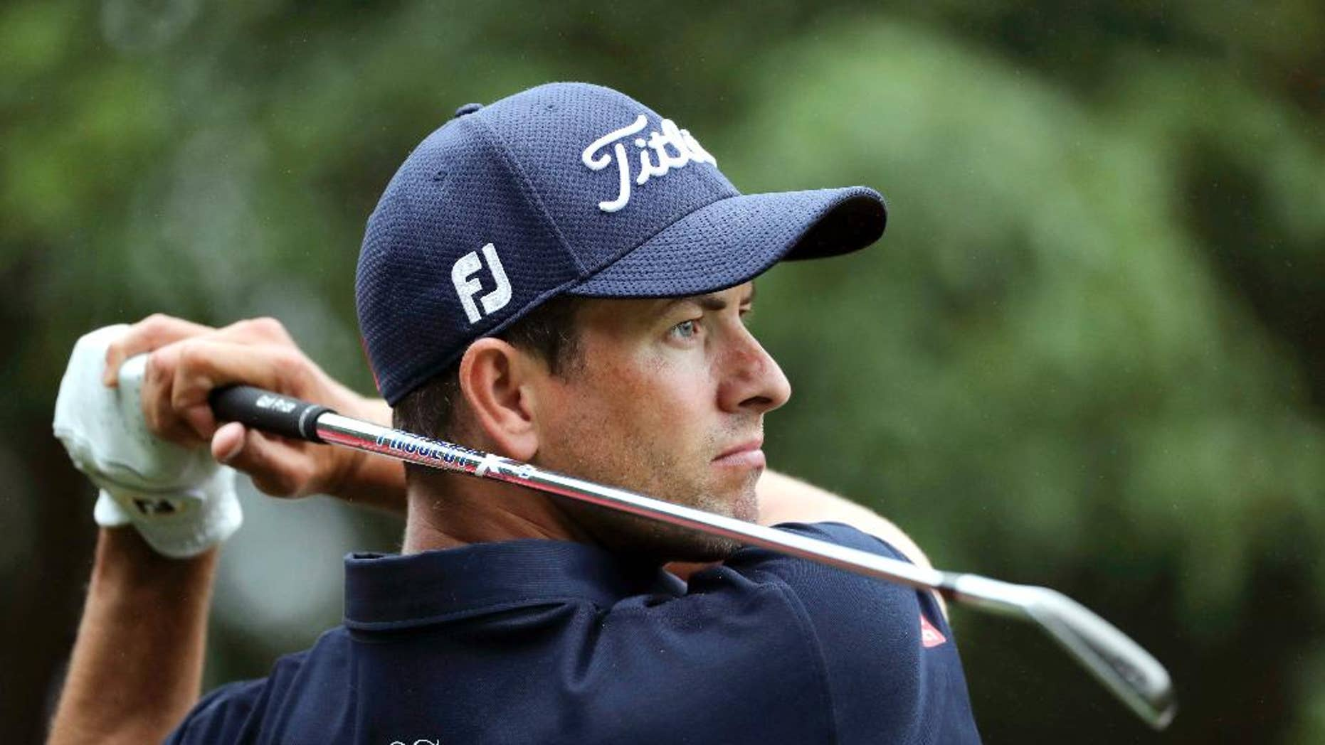 FILE - In this Oct. 27, 2016, file photo, Adam Scott of Australia hits the ball from a sand bank during the WGC-HSBC Champions golf tournament at the Sheshan International Golf Club in Shanghai, China. On Friday, Scott put together back-to-back rounds of 68 and feels like he's really back in the swing of things as he heads into the weekend at the Australian PGA Championship four shots off the pace. (AP Photo/Ng Han Guan, File)