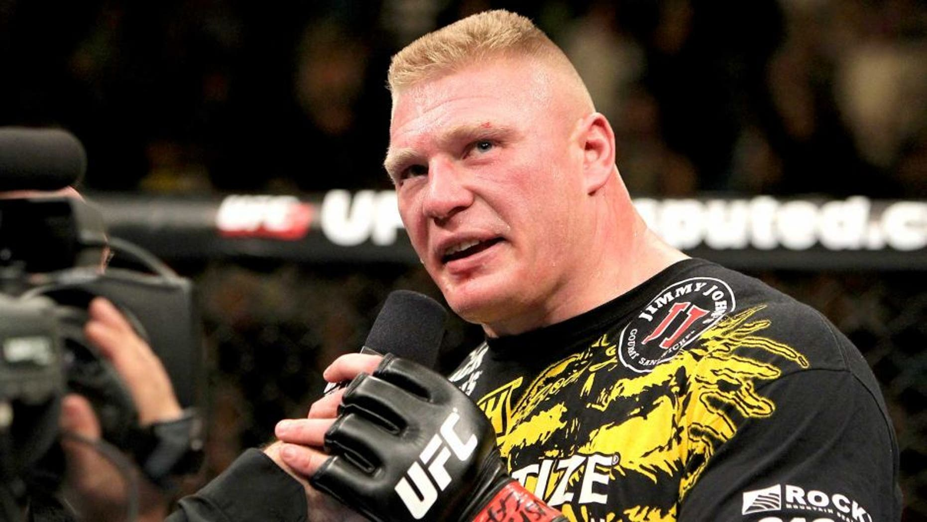 LAS VEGAS, NV - DECEMBER 30: Brock Lesnar announces his retirement in the Octagon after losing to Alistair Overeem during the UFC 141 event at the MGM Grand Garden Arena on December 30, 2011 in Las Vegas, Nevada. (Photo by Josh Hedges/Zuffa LLC/Zuffa LLC via Getty Images)