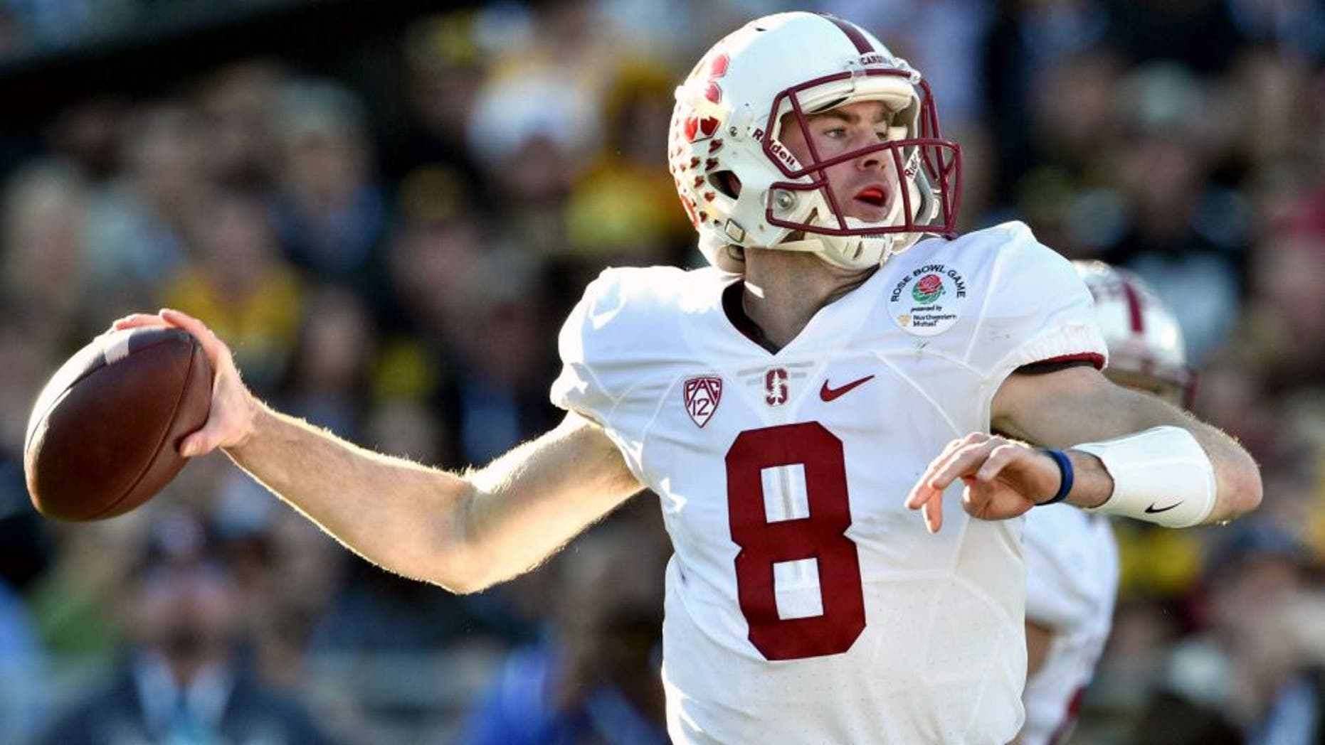 Jan 1, 2016; Pasadena, CA, USA; Stanford Cardinal quarterback Kevin Hogan (8) drops back to pass against the Iowa Hawkeyes during the second quarter in the 2016 Rose Bowl at Rose Bowl. Mandatory Credit: Kirby Lee-USA TODAY Sports