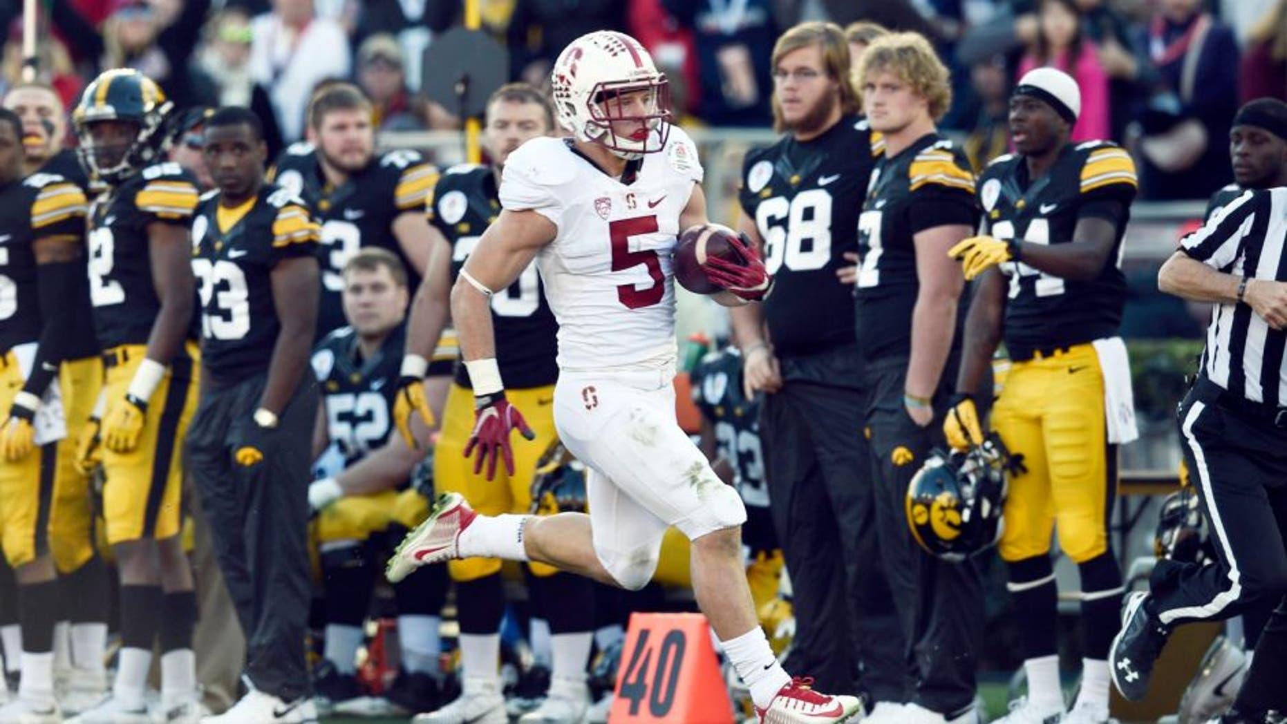 Jan 1, 2016; Pasadena, CA, USA; Stanford Cardinal running back Christian McCaffrey (5) runs against the Iowa Hawkeyes during the second quarter in the 2016 Rose Bowl at Rose Bowl. Mandatory Credit: Gary Vasquez-USA TODAY Sports