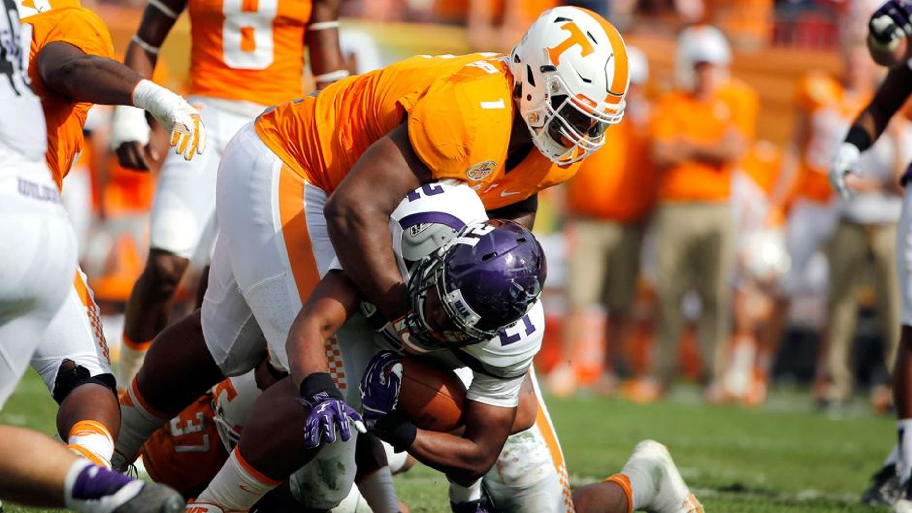Jan 1, 2016; Tampa, FL, USA; Tennessee Volunteers defensive lineman Kahlil McKenzie (1) tackles Northwestern Wildcats running back Justin Jackson (21) during the first half in the 2016 Outback Bowl at Raymond James Stadium. Mandatory Credit: Kim Klement-USA TODAY Sports
