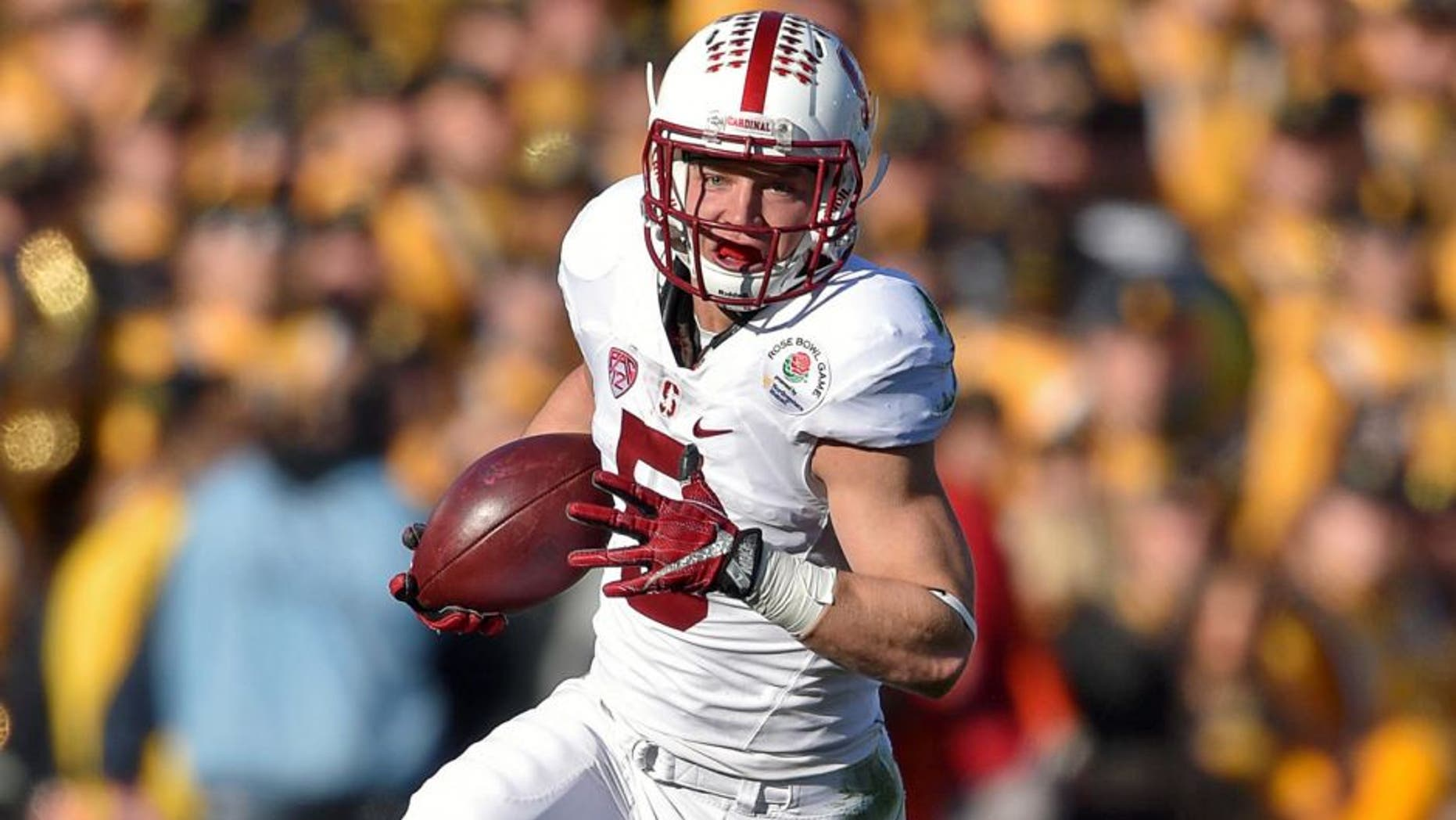 Jan 1, 2016; Pasadena, CA, USA; Stanford Cardinal running back Christian McCaffrey (5) runs against the Iowa Hawkeyes during the first quarter in the 2016 Rose Bowl at Rose Bowl. Mandatory Credit: Kirby Lee-USA TODAY Sports