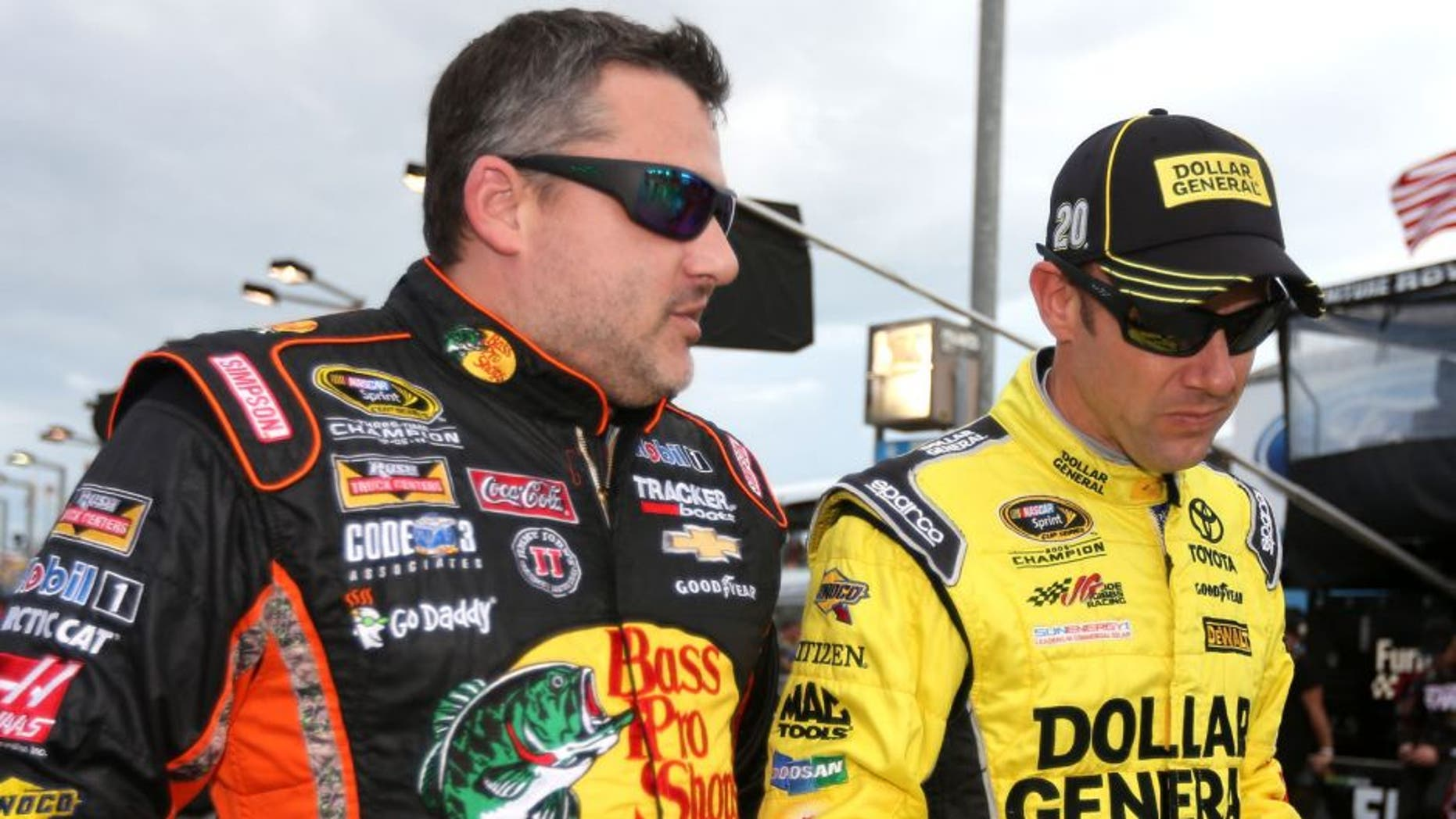 HOMESTEAD, FL - NOVEMBER 22: Tony Stewart, driver of the #14 Bass Pro Shops/Mobil 1 Chevrolet, talks to Matt Kenseth, driver of the #20 Dollar General Toyota, during the NASCAR Sprint Cup Series Ford EcoBoost 400 at Homestead-Miami Speedway on November 22, 2015 in Homestead, Florida. (Photo by Chris Graythen/Getty Images)