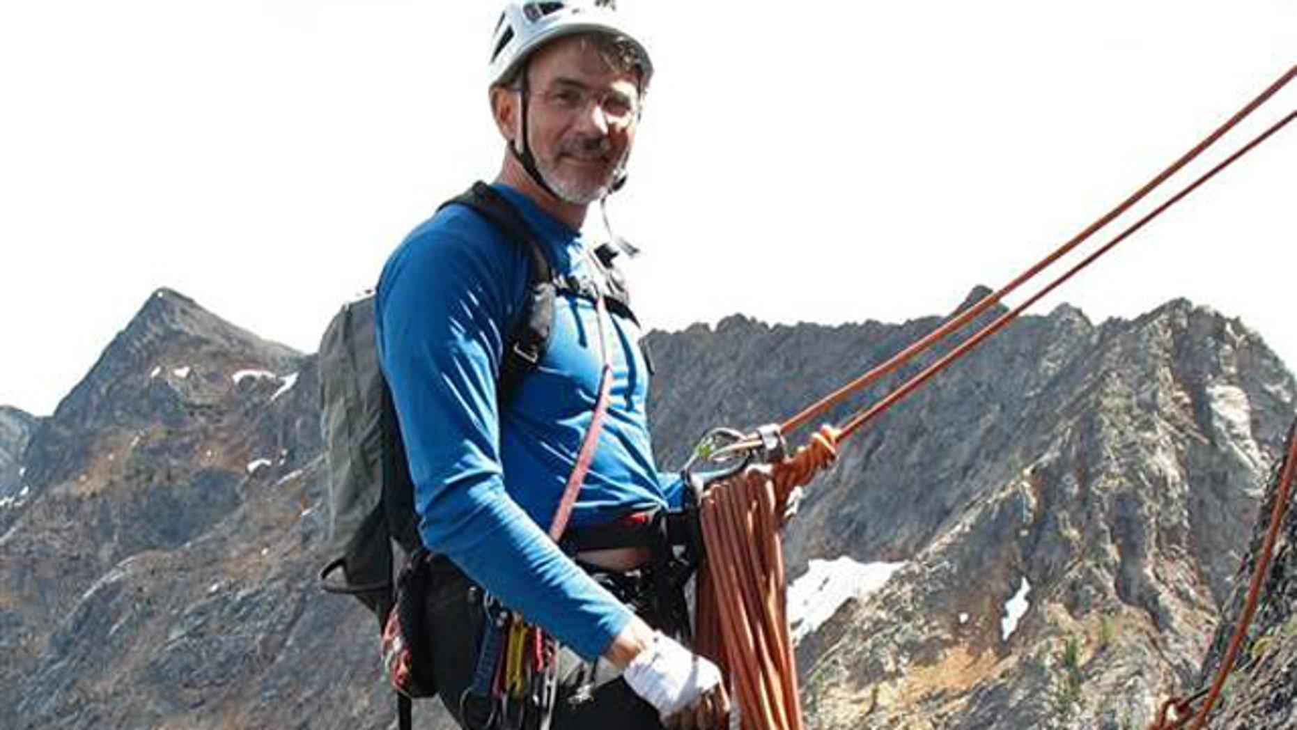 Doug Walker is pictured mountain climbing.