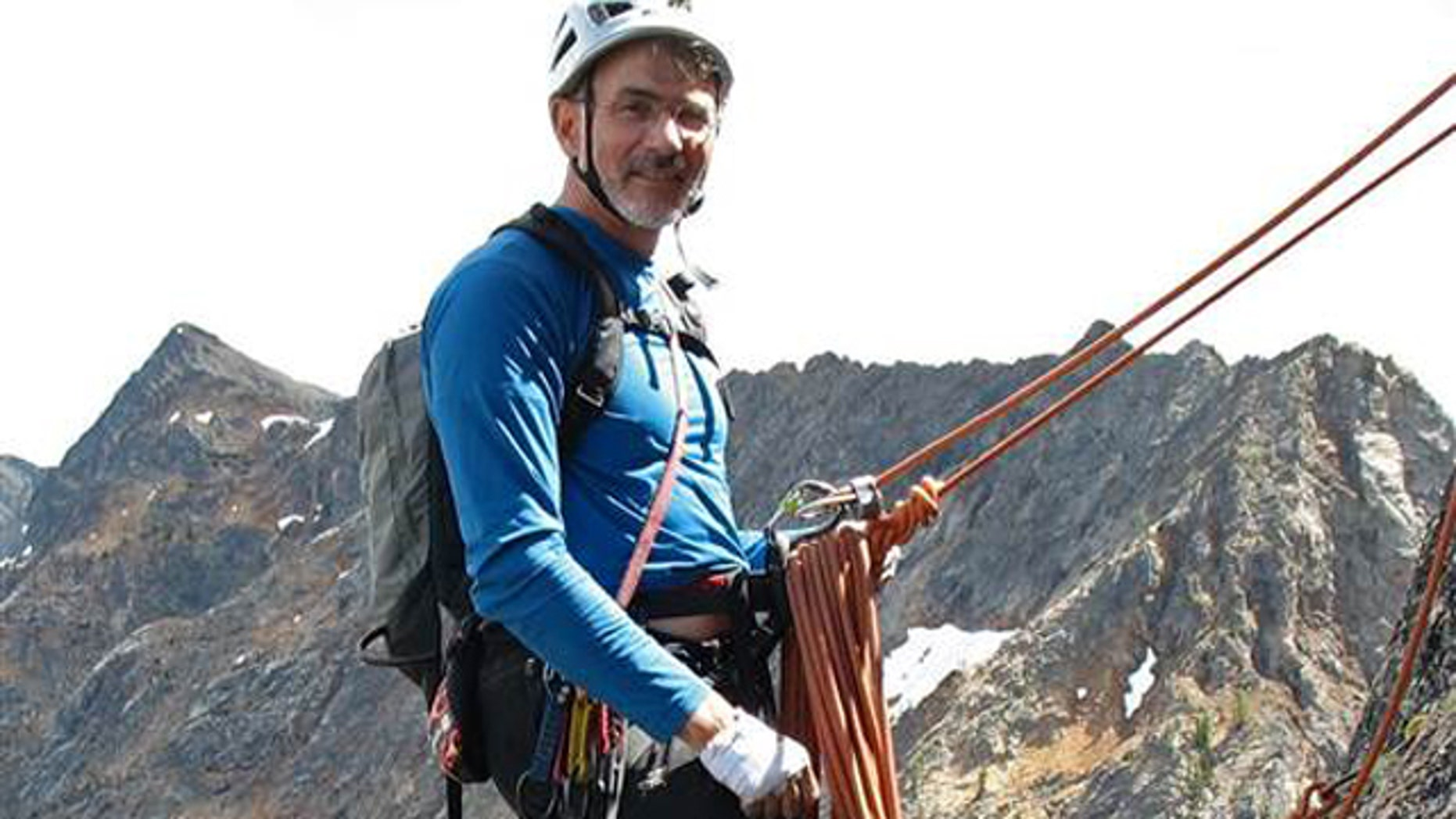 Doug Walker is pictured mountain climbing.