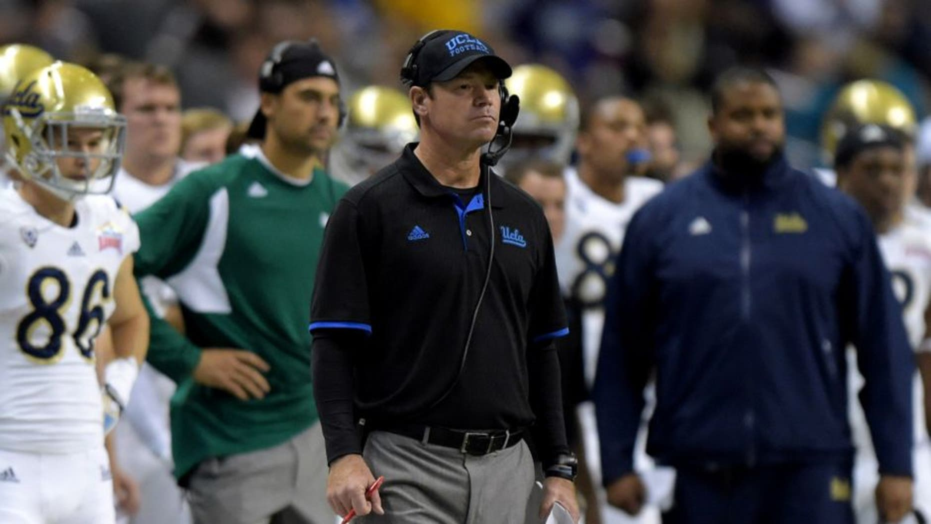 Jan 2, 2015; San Antonio, TX, USA; UCLA Bruins coach Jim Mora watches on the sidelines against the Kansas State Wildcats in the 2015 Alamo Bowl at Alamodome. UCLA defeated Kansas State 40-35. Mandatory Credit: Kirby Lee-USA TODAY Sports