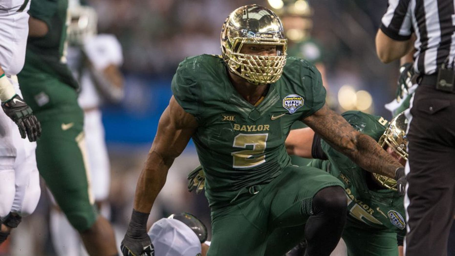 Jan 1, 2015; Arlington, TX, USA; Baylor Bears defensive end Shawn Oakman (2) celebrates his sack of Michigan State Spartans quarterback Connor Cook (18) during the first half in the 2015 Cotton Bowl Classic at AT&T Stadium. Mandatory Credit: Jerome Miron-USA TODAY Sports