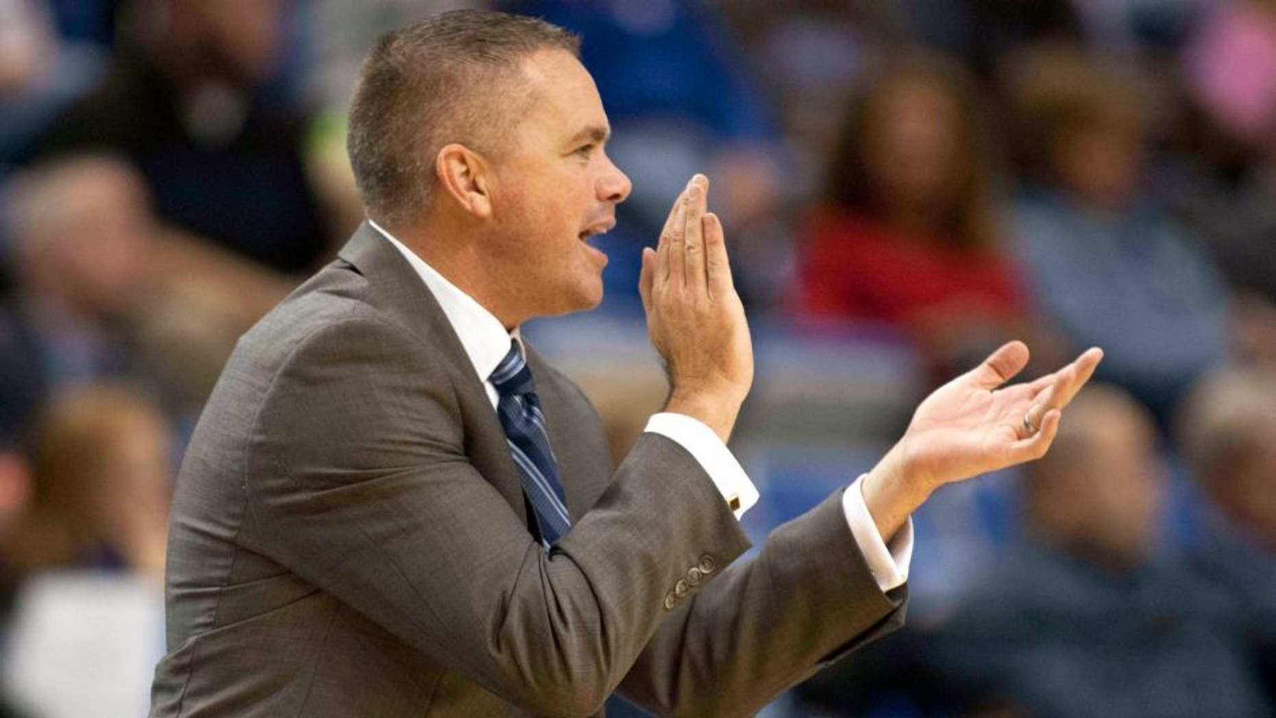 Dec 3, 2014; Terre Haute, IN, USA; Butler Bulldogs head coach Chris Holtmann applauds his team from the sideline in the second half of the game against the Indiana State Sycamores at Hulman Center. Butler won 77-54. Mandatory Credit: Trevor Ruszkowski-USA TODAY Sports