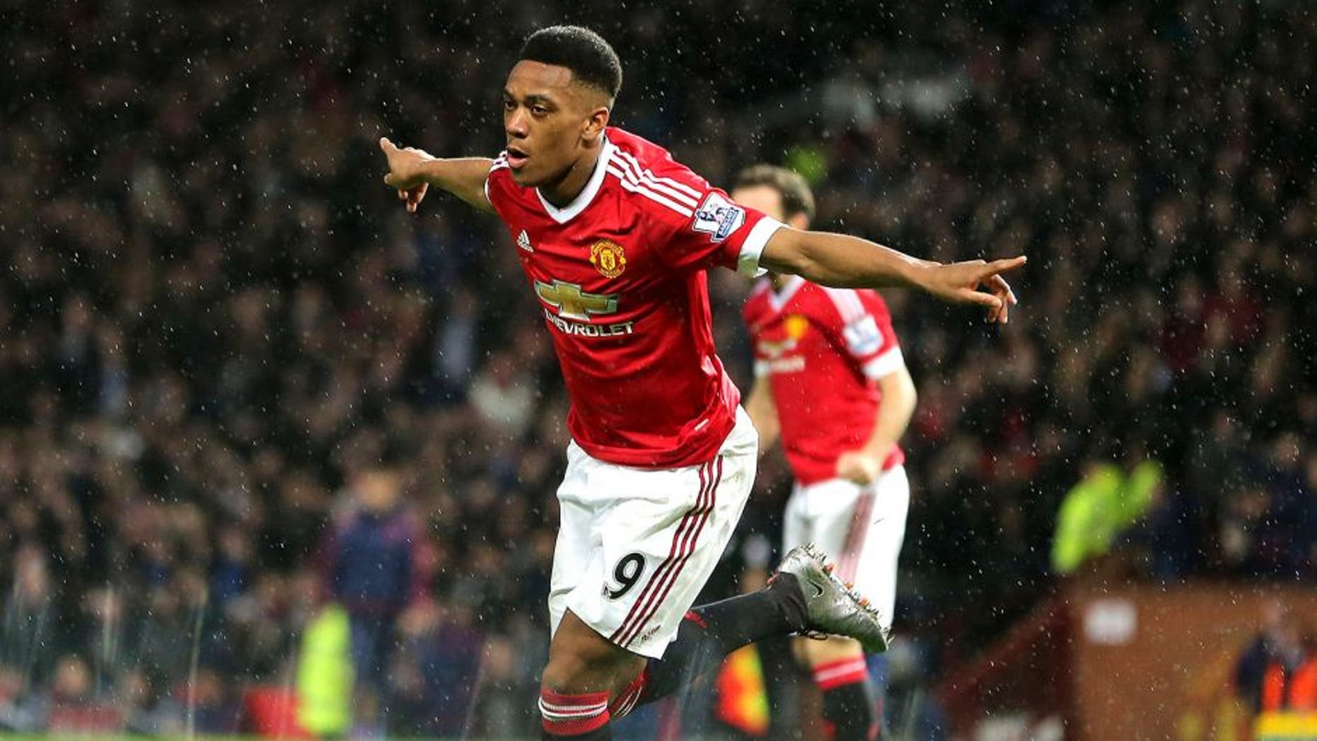 MANCHESTER, ENGLAND - JANUARY 02: Anthony Martial of Manchester United celebrates after scoring a goal to make it 1-0 during the Barclays Premier League match between Manchester United and Swansea City at Old Trafford on January 2, 2016 in Manchester, England. (Photo by James Baylis - AMA/Getty Images)