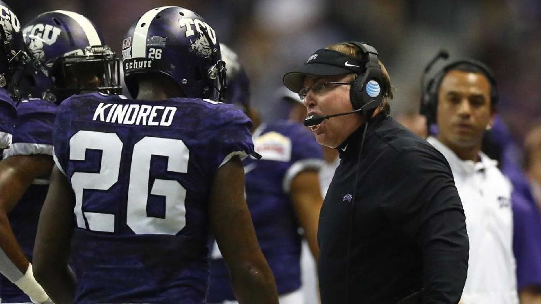 SAN ANTONIO, TX - JANUARY 02: Head coach Gary Patterson of the TCU Horned Frogs talks with Derrick Kindred #26 during the Valero Alamo Bowl at Alamodome on January 2, 2016 in San Antonio, Texas. (Photo by Ronald Martinez/Getty Images)