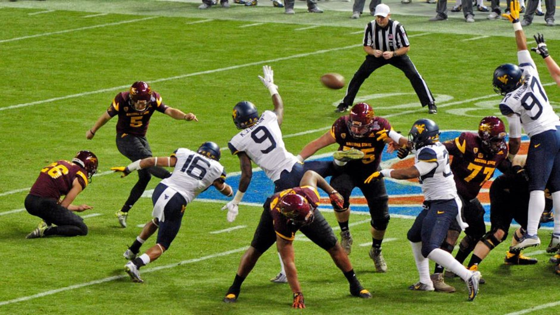 Jan 2, 2016; Phoenix, AZ, USA; Arizona State Sun Devils place kicker Zane Gonzalez (5) kicks a field goal during the first half against the West Virginia Mountaineers at Chase Field during the Cactus Bowl. Mandatory Credit: Matt Kartozian-USA TODAY Sports