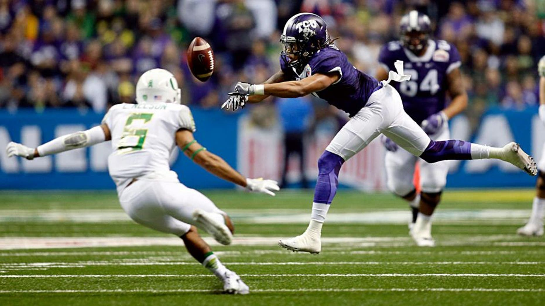 Jan 2, 2016; San Antonio, TX, USA; TCU Horned Frogs wide receiver Kolby Listenbee (7) misses a catch as Oregon Ducks safety Charles Nelson (6) defends in the 2016 Alamo Bowl at the Alamodome. Mandatory Credit: Erich Schlegel-USA TODAY Sports
