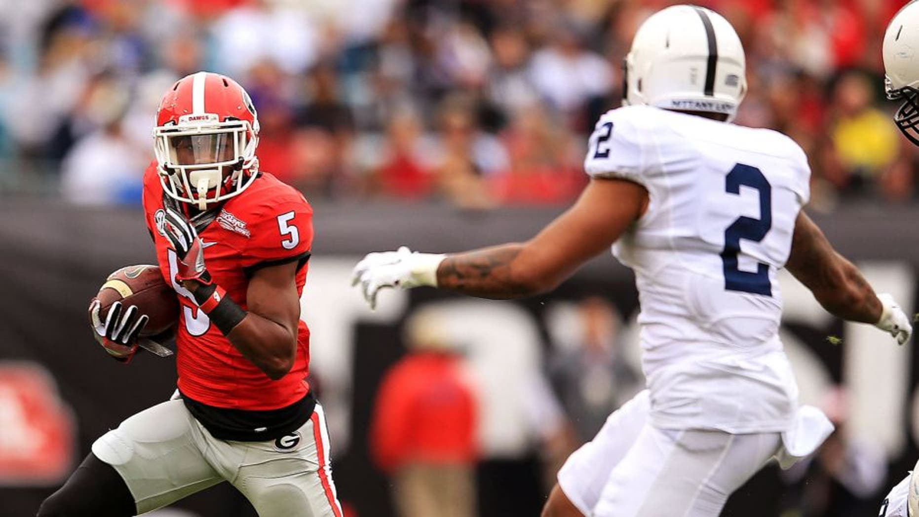 JACKSONVILLE, FL - JANUARY 02: Terry Godwin #5 of the Georgia Bulldogs carries as Marcus Allen #2 of the Penn State Nittany Lions defends during the first half of the TaxSlayer Bowl game at EverBank Field between the Georgia Bulldogs and the Penn State Nittany Lions on January 2, 2016 in Jacksonville, Florida. (Photo by Rob Foldy/Getty Images)