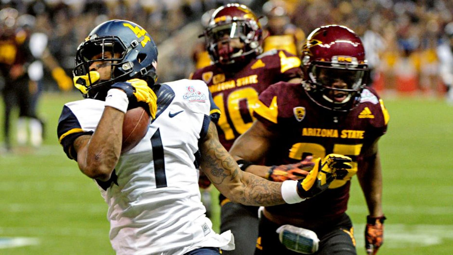 Jan 2, 2016; Phoenix, AZ, USA; West Virginia Mountaineers wide receiver Shelton Gibson (1) runs for a touchdown as Arizona State Sun Devils defensive back Kweishi Brown (10) and defensive back Kareem Orr (25) pursue during the first half at Chase Field during the Cactus Bowl. Mandatory Credit: Matt Kartozian-USA TODAY Sports